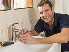 A very happy engineer washing his hands